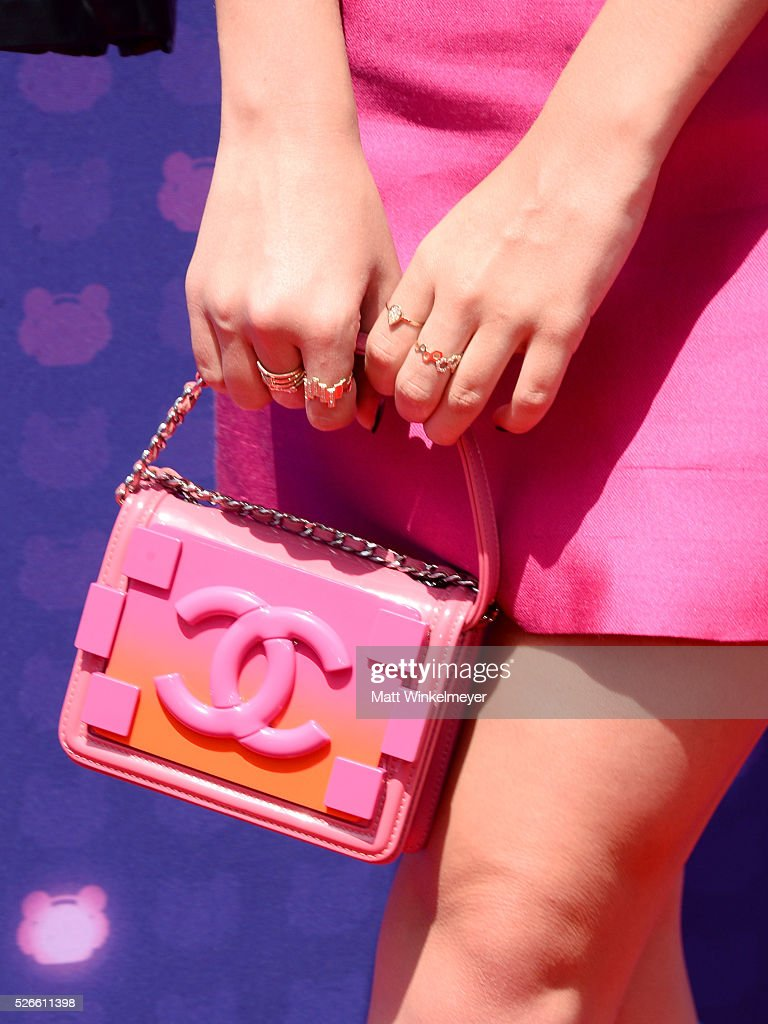 Actress <a gi-track='captionPersonalityLinkClicked' href=/galleries/search?phrase=Kelli+Berglund&family=editorial&specificpeople=8564069 ng-click='$event.stopPropagation()'>Kelli Berglund</a>, jewelry and purse detail, attends the 2016 Radio Disney Music Awards at Microsoft Theater on April 30, 2016 in Los Angeles, California.