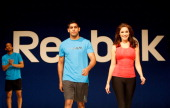 Actress Kelly Brook and boxer Amir Khan appear on the runway to showcase the new Reebok SS11 fitness collection including the Zigtech and Easytone...