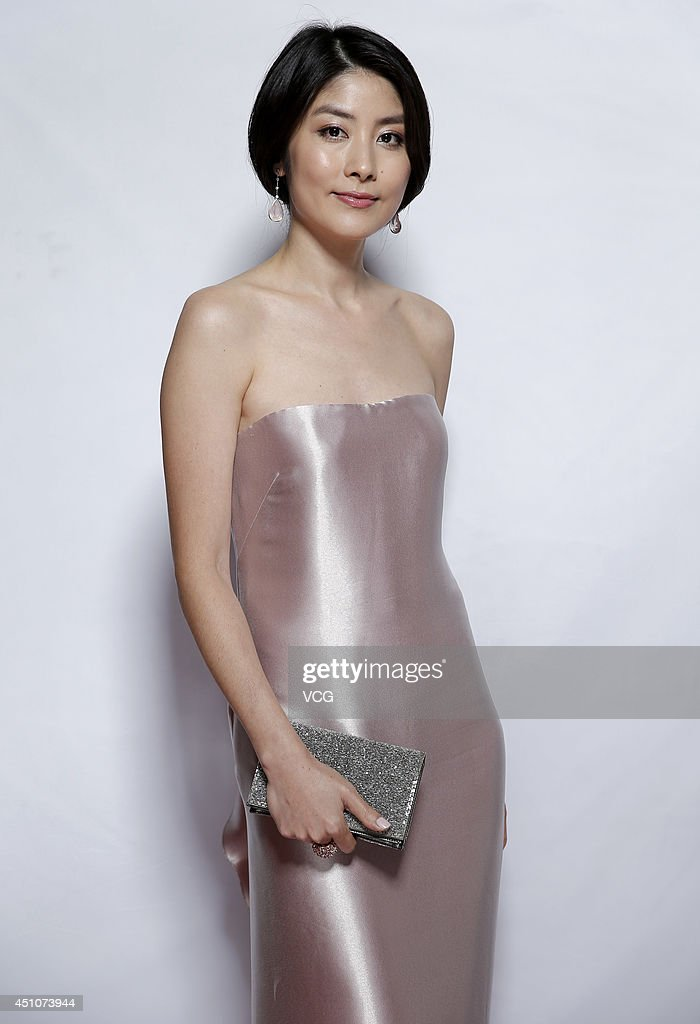 Actress <a gi-track='captionPersonalityLinkClicked' href=/galleries/search?phrase=Kelly+Chen&family=editorial&specificpeople=2125219 ng-click='$event.stopPropagation()'>Kelly Chen</a> attends closing and award ceremony of 17th Shanghai International Film Festival at Shanghai Grand Theatre on June 22, 2014 in Shanghai, China.