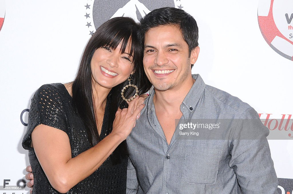 Actress <a gi-track='captionPersonalityLinkClicked' href=/galleries/search?phrase=Kelly+Hu&family=editorial&specificpeople=202918 ng-click='$event.stopPropagation()'>Kelly Hu</a> (L) and actor <a gi-track='captionPersonalityLinkClicked' href=/galleries/search?phrase=Nicholas+Gonzalez&family=editorial&specificpeople=215254 ng-click='$event.stopPropagation()'>Nicholas Gonzalez</a> attend the 4th annual Variety's Texas Hold 'Em poker tournament to benefit 'The Children's Charity Of Southern California' at Paramount Studios on July 16, 2014 in Hollywood, California.