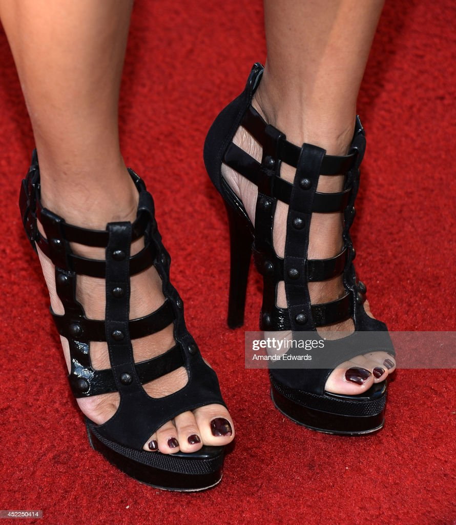 Actress <a gi-track='captionPersonalityLinkClicked' href=/galleries/search?phrase=Kelly+Hu&family=editorial&specificpeople=202918 ng-click='$event.stopPropagation()'>Kelly Hu</a> (shoe detail) arrives at the 4th Annual Variety - The Children's Charity of Southern CA Texas Hold 'Em Poker Tournament at Paramount Studios on July 16, 2014 in Hollywood, California.