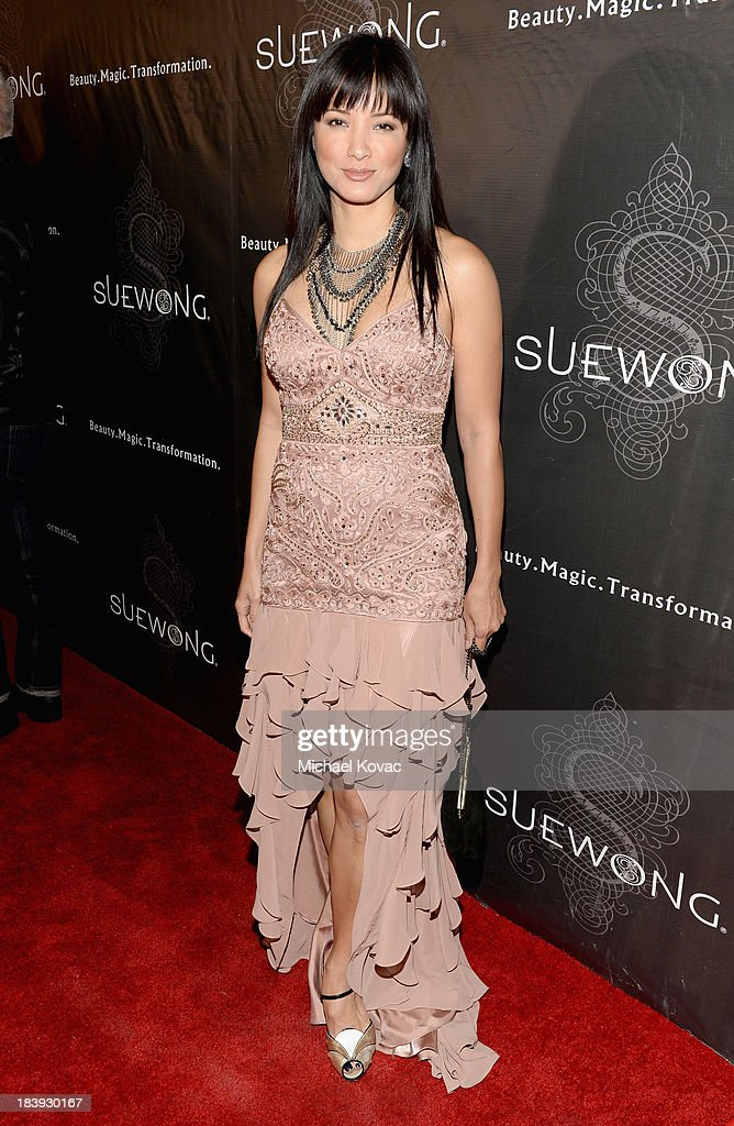 Actress <a gi-track='captionPersonalityLinkClicked' href=/galleries/search?phrase=Kelly+Hu&family=editorial&specificpeople=202918 ng-click='$event.stopPropagation()'>Kelly Hu</a> attends Sue Wong 'Jazz Babies' Spring 2014 Runway Show on October 9, 2013 in Los Angeles, California.