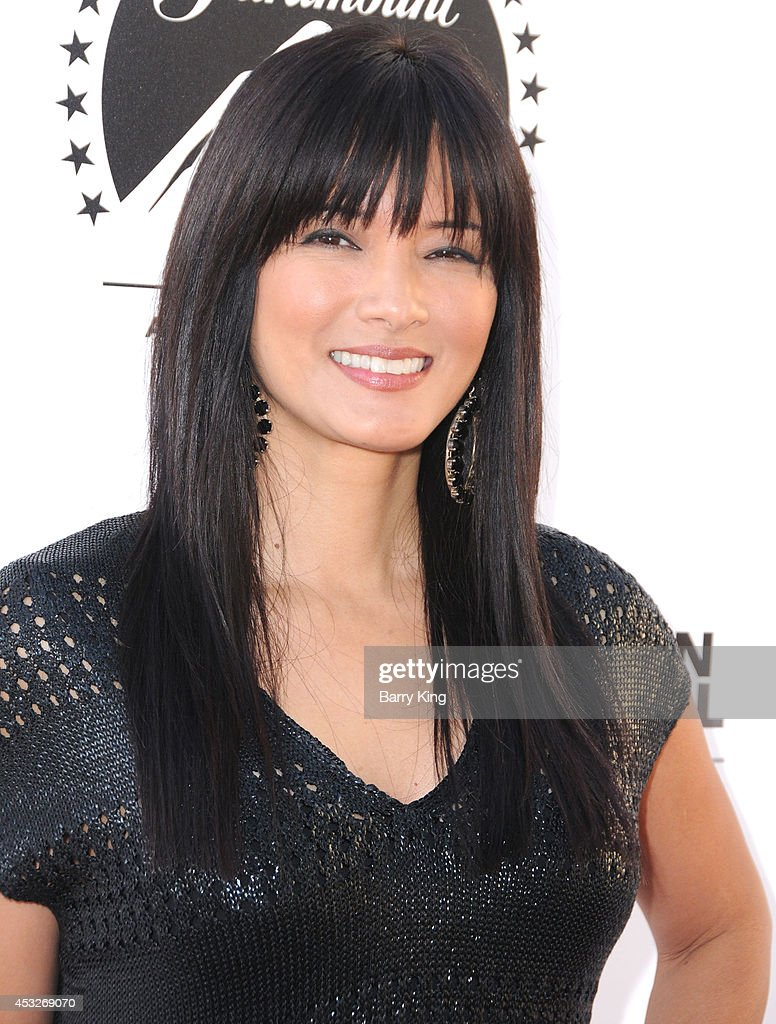 Actress <a gi-track='captionPersonalityLinkClicked' href=/galleries/search?phrase=Kelly+Hu&family=editorial&specificpeople=202918 ng-click='$event.stopPropagation()'>Kelly Hu</a> attends the 4th annual Variety's Texas Hold 'Em poker tournament to benefit 'The Children's Charity Of Southern California' at Paramount Studios on July 16, 2014 in Hollywood, California.