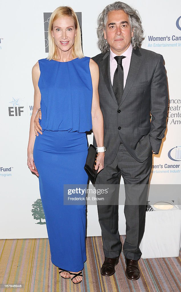 Actress Kelly Lynch (L) and Mitch Glazer attend the EIF Women's Cancer Research Fund's 16th Annual 'An Unforgettable Evening' presented by Saks Fifth Avenue at the Beverly Wilshire Four Seasons Hotel on May 2, 2013 in Beverly Hills, California.