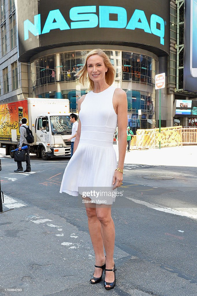 Actress Kelly Lynch poses outside of NASDAQ at Times Square on June 12, 2013 in New York City.