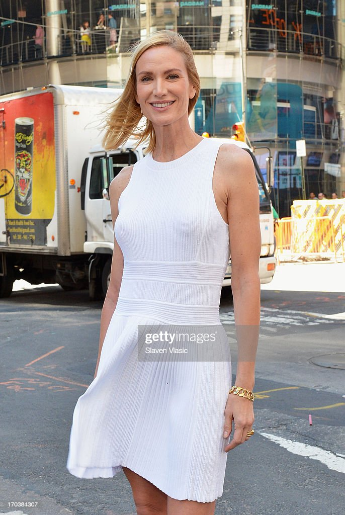 Actress <a gi-track='captionPersonalityLinkClicked' href=/galleries/search?phrase=Kelly+Lynch&family=editorial&specificpeople=203037 ng-click='$event.stopPropagation()'>Kelly Lynch</a> poses outside of NASDAQ at Times Square on June 12, 2013 in New York City.