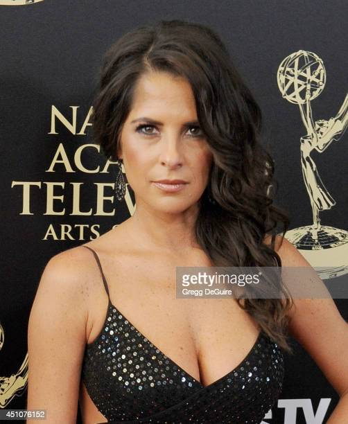Actress Kelly Monaco arrives at the 41st Annual Daytime Emmy Awards at The Beverly Hilton Hotel on June 22 2014 in Beverly Hills California