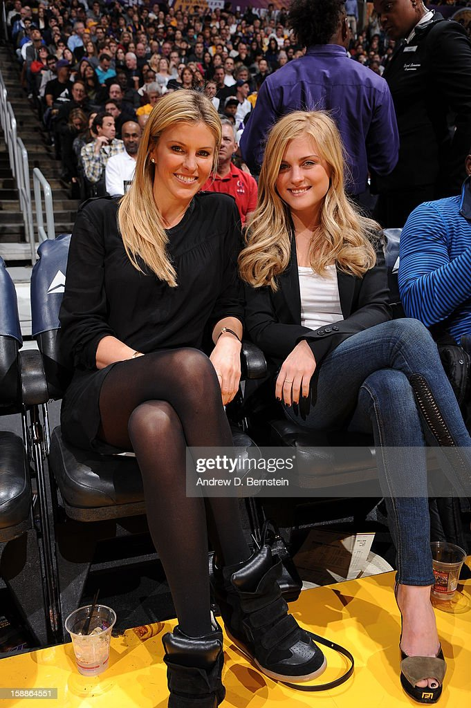 Actress Kelly Noonan (L) and guest pose for a photograph at halftime of a game between the Philadelphia 76ers and the Los Angeles Lakers at Staples Center on January 1, 2013 in Los Angeles, California.