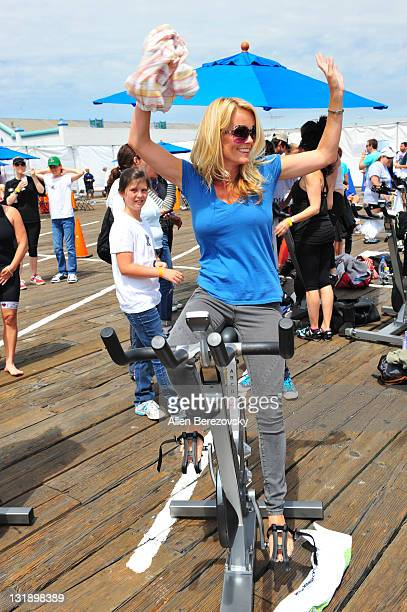 Actress Kelly Packard rides a sationary bike at the Pedal On The Pier charity event benefiting inner city schools at Santa Monica Pier on June 5 2011...