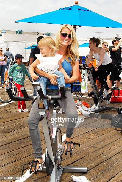 Actress Kelly Packard rides in The 100 Mile Man And The Harold Robinson Foundation's 'Pedal On The Pier' Fundraiser at Santa Monica Pier on June 5...