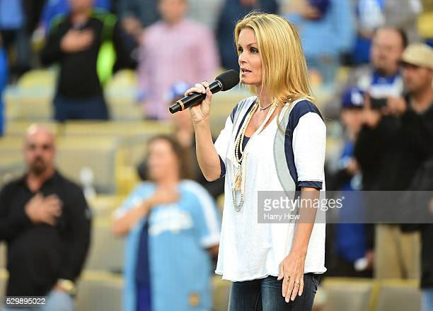 Actress Kelly Packard sings the National Anthem before the game between the New York Mets and the Los Angeles Dodgers at Dodger Stadium on May 09...