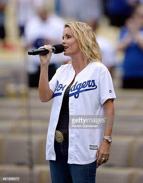 Actress Kelly Packard sings the National Anthem prior to the start of the Los Angeles Dodgers and San Diego Padres baseball game at Dodger Stadium...