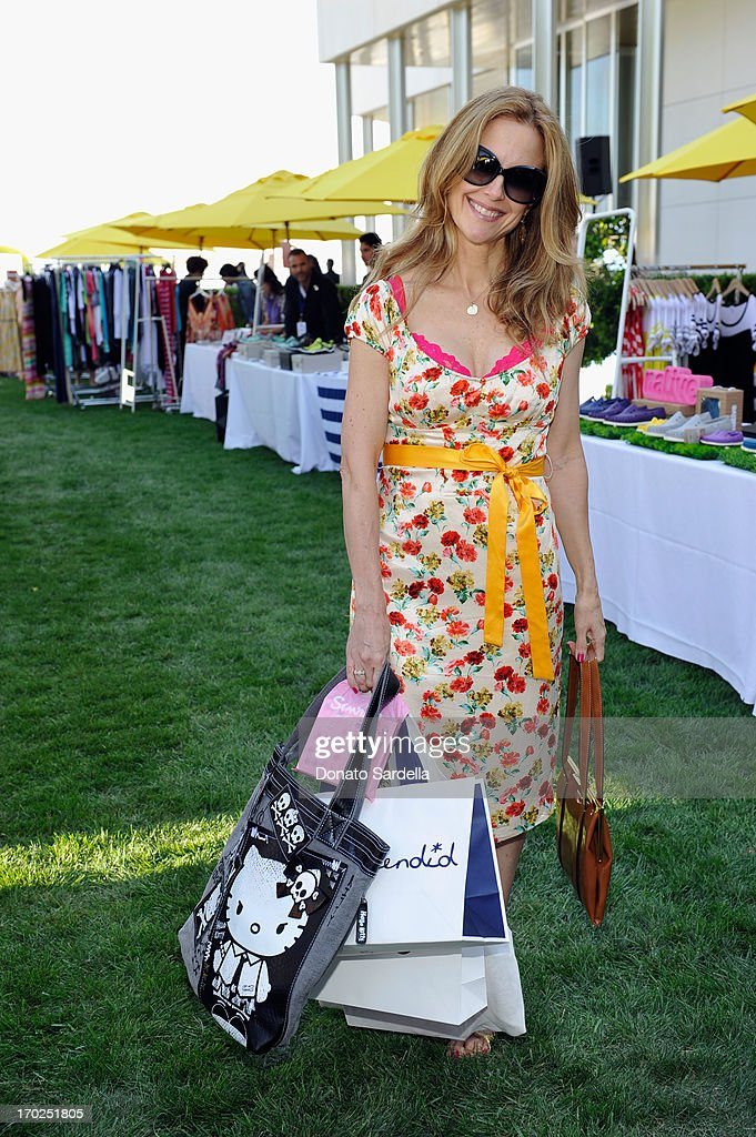 Actress <a gi-track='captionPersonalityLinkClicked' href=/galleries/search?phrase=Kelly+Preston&family=editorial&specificpeople=159434 ng-click='$event.stopPropagation()'>Kelly Preston</a> attends the 1st Annual Children Mending Hearts Style Sunday on June 9, 2013 in Beverly Hills, California.