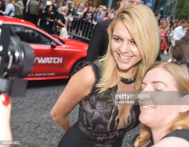 US actress Kelly Rohrbach with fans during the Baywatch European Premiere Party on May 31 2017 in Berlin Germany