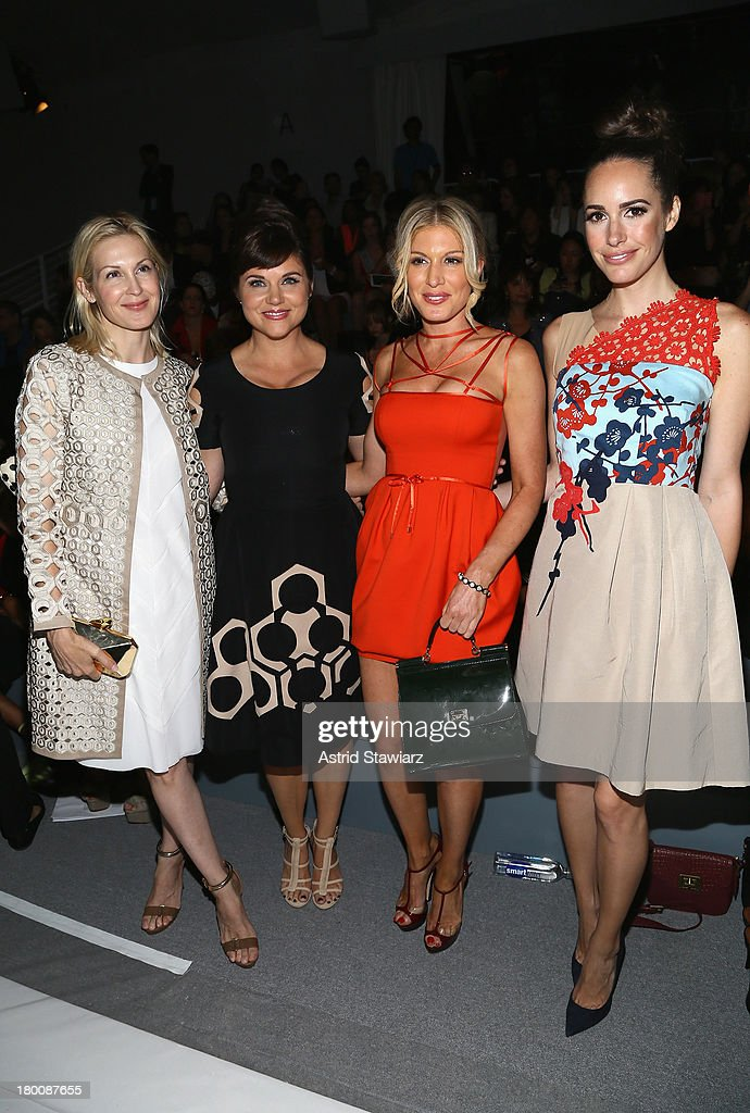 Actress <a gi-track='captionPersonalityLinkClicked' href=/galleries/search?phrase=Kelly+Rutherford&family=editorial&specificpeople=217987 ng-click='$event.stopPropagation()'>Kelly Rutherford</a>, actress <a gi-track='captionPersonalityLinkClicked' href=/galleries/search?phrase=Tiffani+Thiessen&family=editorial&specificpeople=221649 ng-click='$event.stopPropagation()'>Tiffani Thiessen</a>, <a gi-track='captionPersonalityLinkClicked' href=/galleries/search?phrase=Hofit+Golan&family=editorial&specificpeople=542603 ng-click='$event.stopPropagation()'>Hofit Golan</a>, and model <a gi-track='captionPersonalityLinkClicked' href=/galleries/search?phrase=Louise+Roe&family=editorial&specificpeople=4300958 ng-click='$event.stopPropagation()'>Louise Roe</a> attend the TRESemme at Vivienne Tam fashion show during Mercedes-Benz Fashion Week Spring 2014 at The Stage at Lincoln Center on September 8, 2013 in New York City.