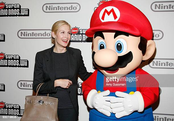 Actress Kelly Rutherford and Mario attend the 25 years of Mario celebration at the Nintendo World Store on November 12 2009 in New York City