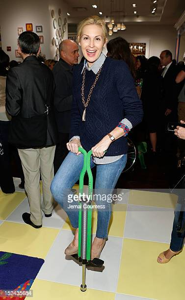 Actress Kelly Rutherford jumps on a pogo stick during the C Wonder Grand Opening at Time Warner Center on September 20 2012 in New York City