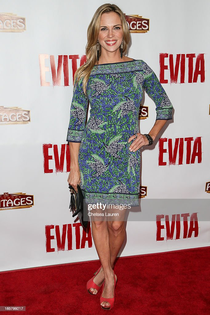 Actress Kelly Sullivan arrives at the opening night red carpet for 'Evita' at the Pantages Theatre on October 24, 2013 in Hollywood, California.