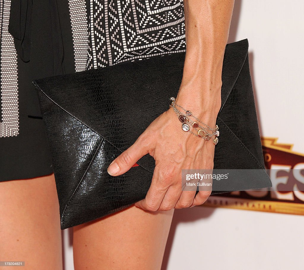 Actress Kelly Sullivan (handbag and jewelry detail) at the premiere of 'Sister Act' at the Pantages Theatre on July 9, 2013 in Hollywood, California.