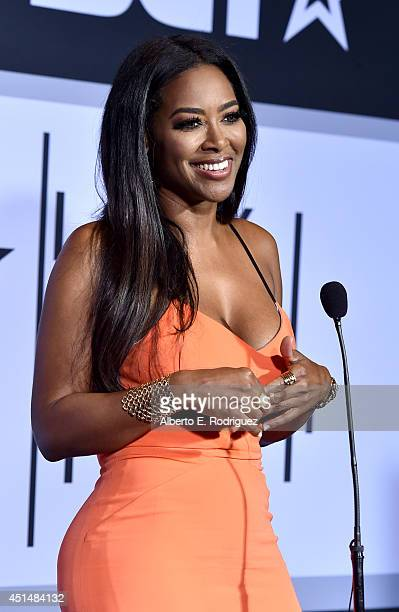 Actress Kenya Moore is interviewed in the Winners Room during the BET AWARDS '14 at Nokia Theatre LA LIVE on June 29 2014 in Los Angeles California
