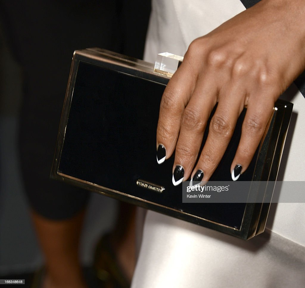 Actress Kerry Washington (handbag detail) arrives at the premiere of 'Peeples' presented by Lionsgate Film and Tyler Perry at ArcLight Hollywood on May 8, 2013 in Hollywood, California.