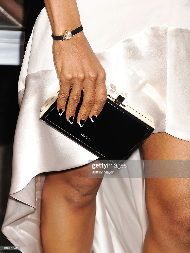 Actress <a gi-track='captionPersonalityLinkClicked' href=/galleries/search?phrase=Kerry+Washington&family=editorial&specificpeople=201534 ng-click='$event.stopPropagation()'>Kerry Washington</a> (handbag, watch detail) at the premiere of 'Peeples' presented by Lionsgate Film and Tyler Perry at ArcLight Hollywood on May 8, 2013 in Hollywood, California.