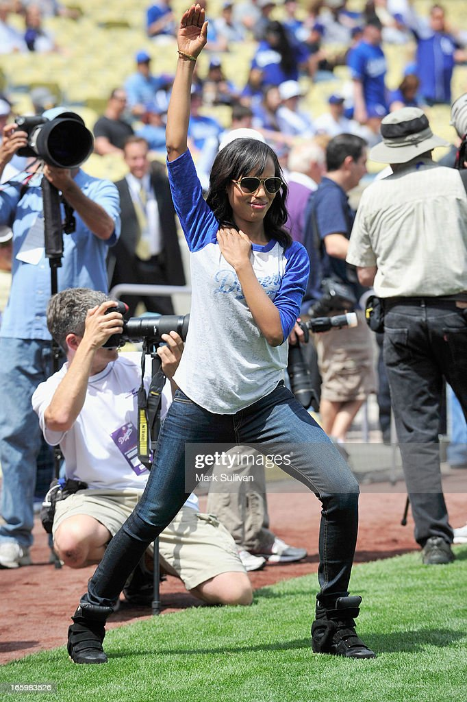 Actress Kerry Washington loosens up announcing the Los Angeles Dodger starting line-up at Dodger Stadium on April 7, 2013 in Los Angeles, California.