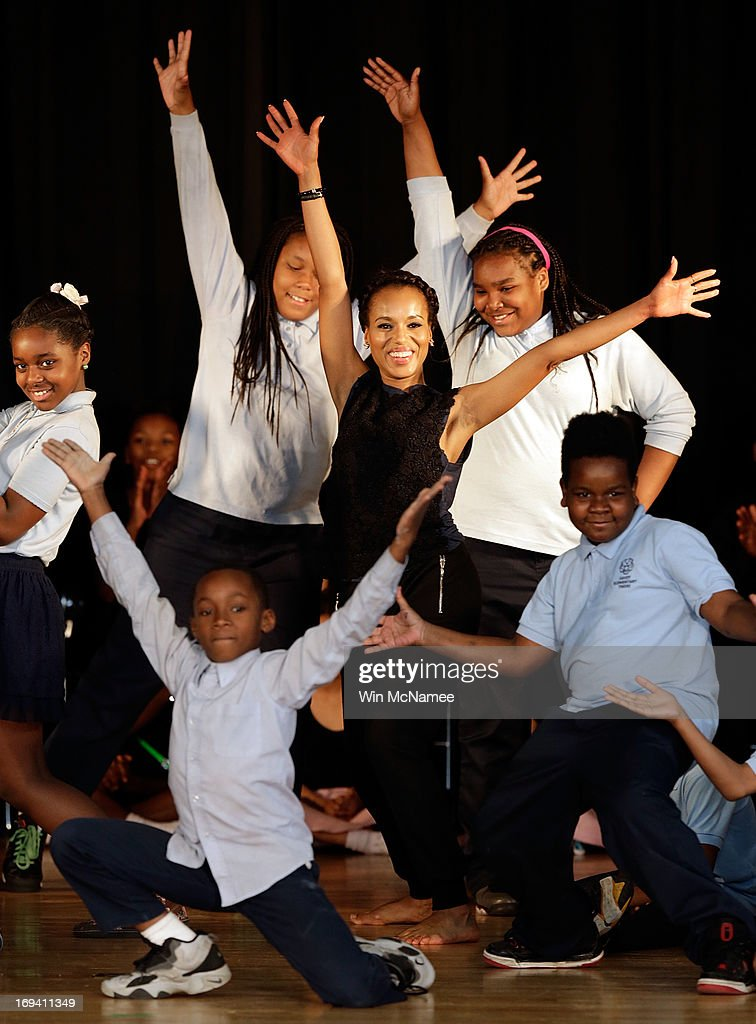 Actress <a gi-track='captionPersonalityLinkClicked' href=/galleries/search?phrase=Kerry+Washington&family=editorial&specificpeople=201534 ng-click='$event.stopPropagation()'>Kerry Washington</a> performs with students during an event while visiting the Savoy School with U.S. first lady <a gi-track='captionPersonalityLinkClicked' href=/galleries/search?phrase=Michelle+Obama&family=editorial&specificpeople=2528864 ng-click='$event.stopPropagation()'>Michelle Obama</a> May 24, 2013 in Washington, DC. The Savoy School, once one of the lowest performing schools in the District of Columbia, has shown significant signs of improvement since being designated as one of eight schools selected last year for the Turnaround Arts Initiative by the President's Committee on the Arts and the Humanities.