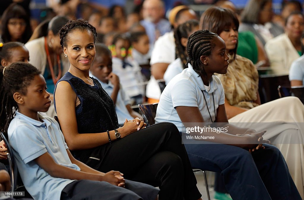 Actress <a gi-track='captionPersonalityLinkClicked' href=/galleries/search?phrase=Kerry+Washington&family=editorial&specificpeople=201534 ng-click='$event.stopPropagation()'>Kerry Washington</a> sits with students during an event with U.S. first lady <a gi-track='captionPersonalityLinkClicked' href=/galleries/search?phrase=Michelle+Obama&family=editorial&specificpeople=2528864 ng-click='$event.stopPropagation()'>Michelle Obama</a> (R) while visiting the Savoy School May 24, 2013 in Washington, DC. The Savoy School, once one of the lowest performing schools in the District of Columbia, has shown significant signs of improvement since being designated as one of eight schools selected last year for the Turnaround Arts Initiative by the President's Committee on the Arts and the Humanities.