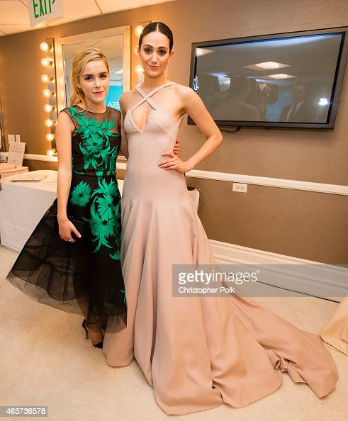 Actress Kiernan Shipka and host Emmy Rossum attend the 17th Costume Designers Guild Awards with presenting sponsor Lacoste at The Beverly Hilton...