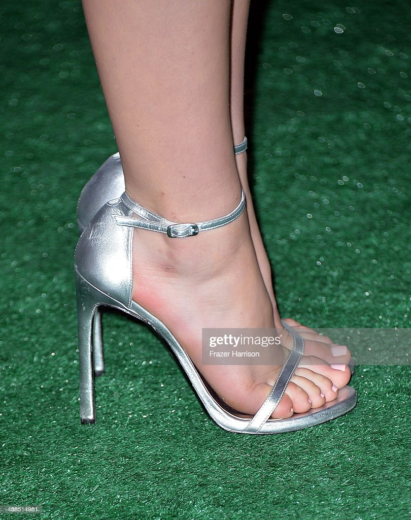 Actress Kiernan Shipka (shoe detail) attends the premiere of Disney's 'Million Dollar Arm' at the El Capitan Theatre on May 6, 2014 in Hollywood, California.