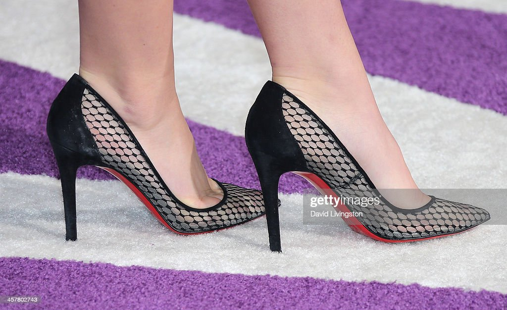 Actress Kiernan Shipka (shoe detail) attends the premiere of Open Road Films' 'Justin Bieber's Believe' at Regal Cinemas L.A. Live on December 18, 2013 in Los Angeles, California.