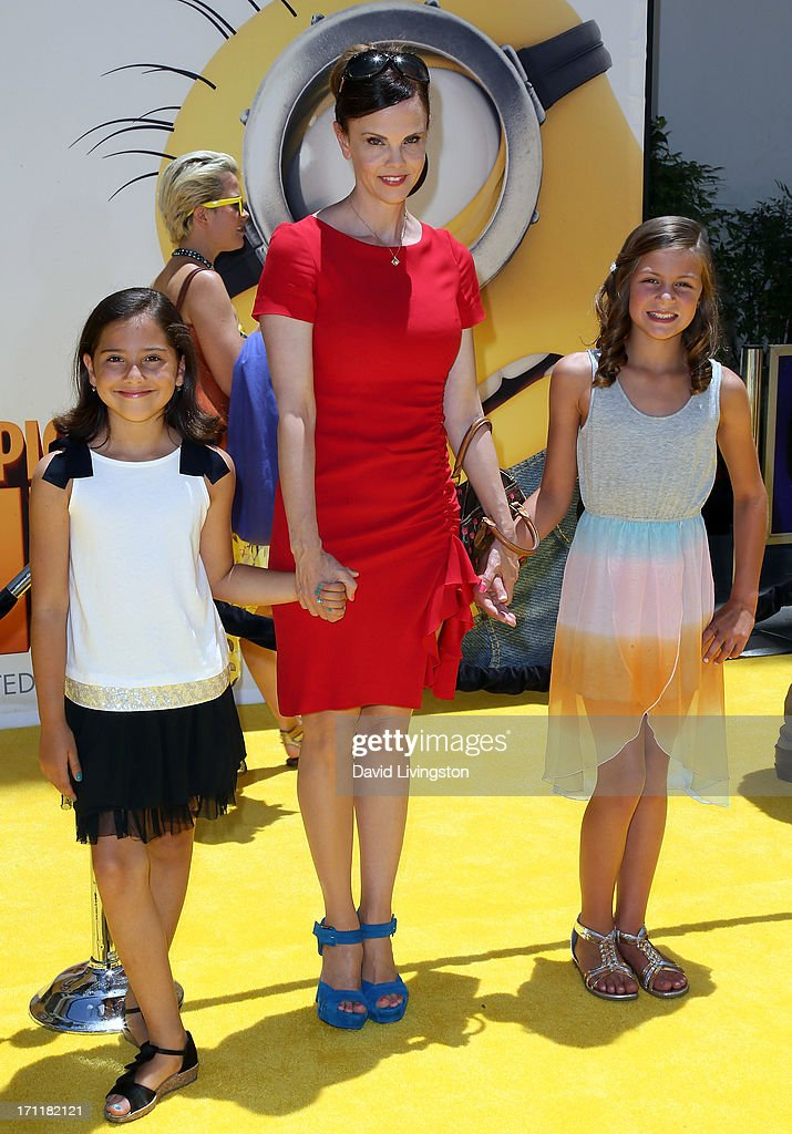 Actress Kiersten Warren (C) attends the premiere of Universal Pictures' 'Despicable Me 2' at the Gibson Amphitheatre on June 22, 2013 in Universal City, California.