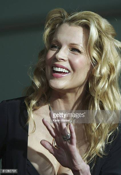 Actress Kim Basinger arrives at the premiere of New Line Cinemas 'Cellular' on September 9 2004 at the Cinerama Dome in Los Angeles California