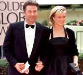 Actress Kim Basinger arrives with her husband actor Alec Baldwin for the 55th Annual Golden Globe Awards at the Beverly Hilton 18 January in Beverly...