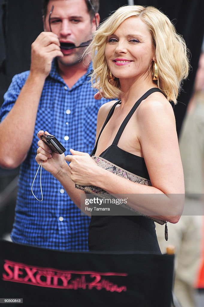Actress Kim Cattrall photographs media people on location at the 'Sex And The City 2' film set at Bergdorf Goodman on September 09, 2009 in New York City.