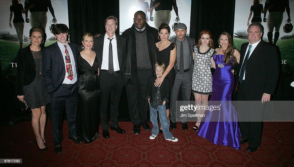 Actress Kim Dickens, Sean Tuohy Jr., Leigh Anne Tuohy, director John Lee Hancock, actor Quinton Aaron, actor Jae Head, actress Sandra Bullock, actor/musician Tim McGraw, actress Lily Collins, Collins Tuohy and Sean Tuohy attend 'The Blind Side' premiere at the Ziegfeld Theatre on November 17, 2009 in New York City.