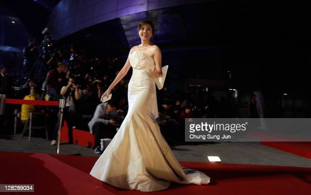 Actress Kim HaNeul arrives for the opening ceremony of the 16th Busan International Film Festival at the Busan Cinema Center on October 6 2011 in...