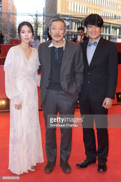 Actress Kim Minhee director Hong Sangsoo and Park HongYeol attend the 'On the Beach at Night Alone' premiere during the 67th Berlinale International...