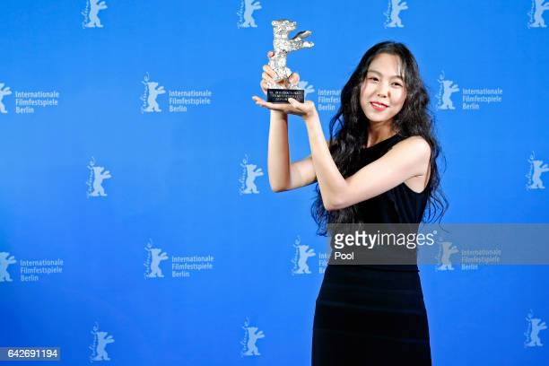 Actress Kim Minhee poses with her Silver Bear for Best Actress backstage after the closing ceremony of the 67th Berlinale International Film Festival...