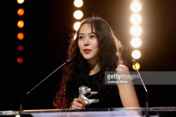 Actress Kim Minhee speaks on stage as she receives the Silver Bear award for best actress at the closing ceremony of the 67th Berlinale International...