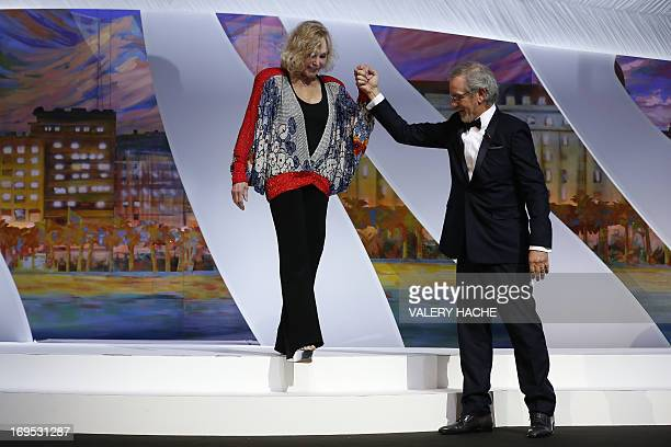 US actress Kim Novak is welcomed on stage by US director and President of the Feature Film Jury Steven Spielberg prior to handing on May 26 2013 the...