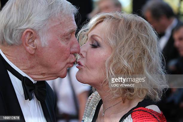 US actress Kim Novak kisses her husband Robert Malloy as they arrive on May 26 2013 for the screening of the film 'Zulu' presented Out of Competition...