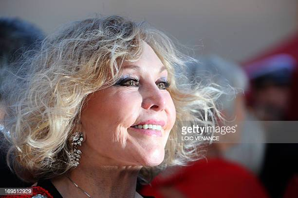 US actress Kim Novak poses on May 26 2013 as she arrives for the screening of the film 'Zulu' presented Out of Competition at the 66th edition of the...