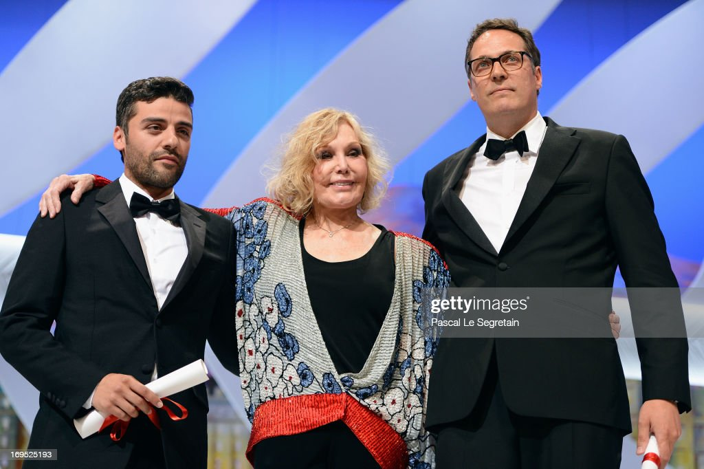 Actress Kim Novak (C) poses with actor Oscar Isaac (L) after he received for directors Joel and Ethan Coen the Grand Prix award for 'Inside Llewyn Davis' on stage during the Closing Ceremony of the 66th Annual Cannes Film Festival at the Palais des Festivals on May 26, 2013 in Cannes, France.