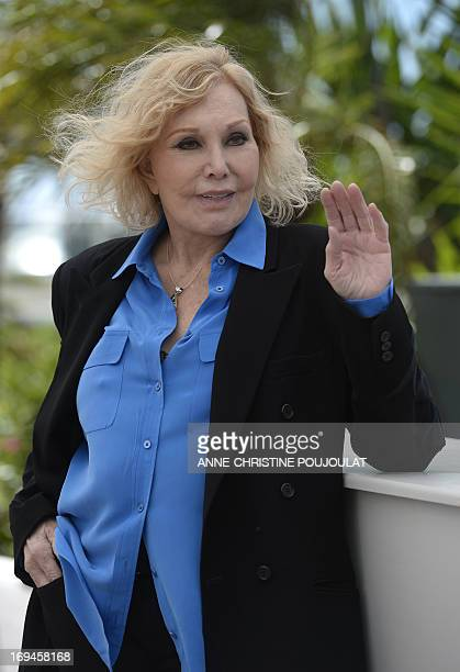 US actress Kim Novak waves on May 25 2013 while posing during a photocall ahead of the screening of the new restored version of the film 'Vertigo'...