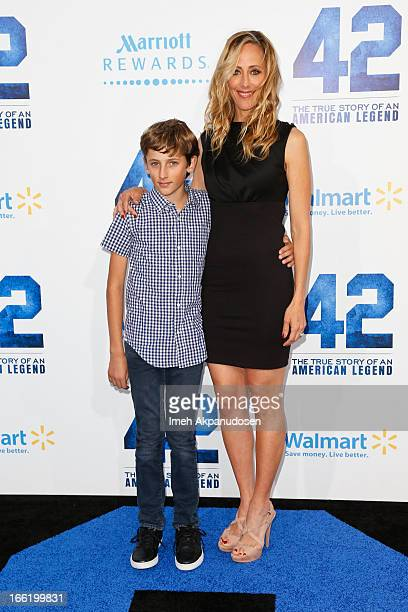 Actress Kim Raver and her son Luke West Boyer attend the premiere of Warner Bros Pictures' And Legendary Pictures' '42' at TCL Chinese Theatre on...