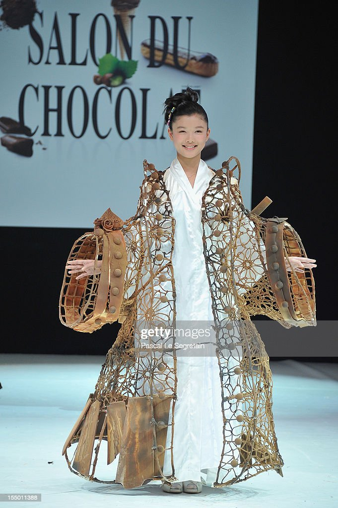 Actress Kim Yoo Jung walks down the runway during the 18th Salon Du Chocolat at Parc des Expositions Porte de Versailles on October 30, 2012 in Paris, France.