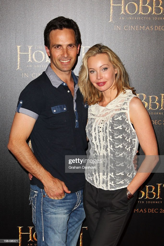 Actress <a gi-track='captionPersonalityLinkClicked' href=/galleries/search?phrase=Kimberley+Davies&family=editorial&specificpeople=646214 ng-click='$event.stopPropagation()'>Kimberley Davies</a> (R) and husband Jason Harvey attend the Melbourne premiere of 'The Hobbit: An Unexpected Journey' at Village Cinemas on December 18, 2012 in Melbourne, Australia.