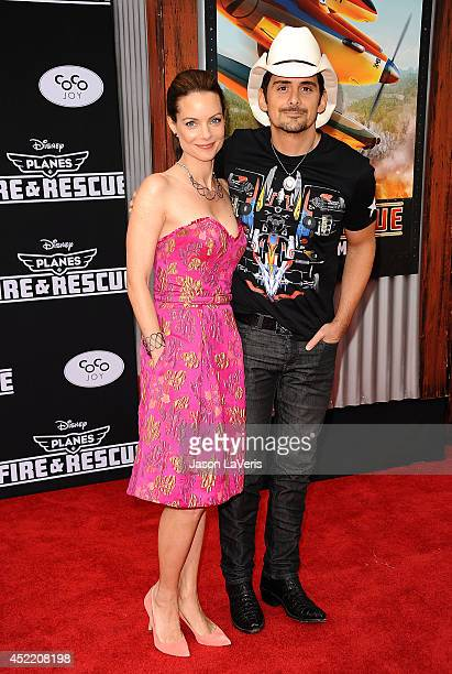 Actress Kimberly WilliamsPaisley and actor Brad Paisley attend the premiere of 'Planes Fire Rescue' at the El Capitan Theatre on July 15 2014 in...